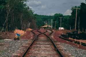 brown metal train railway